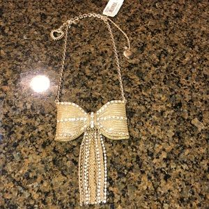 Betsy Johnson bow necklace.